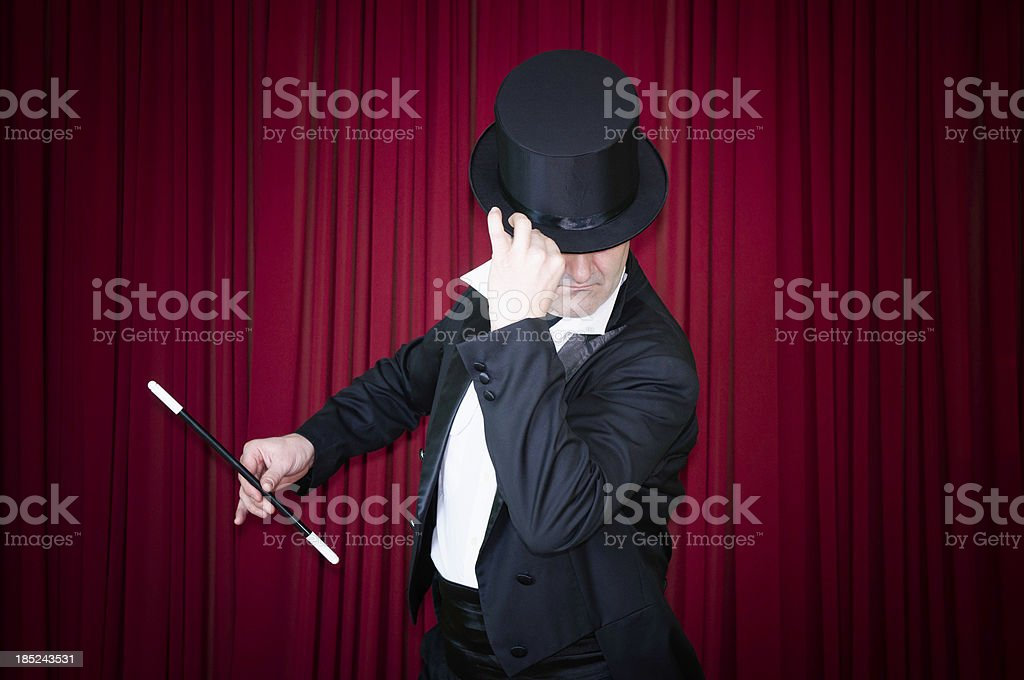 Magician on stage stock photo