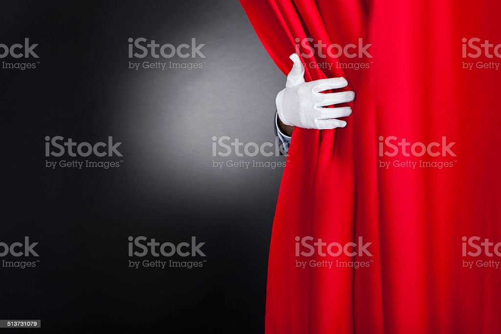 Magician Opening Red Stage Curtain stock photo