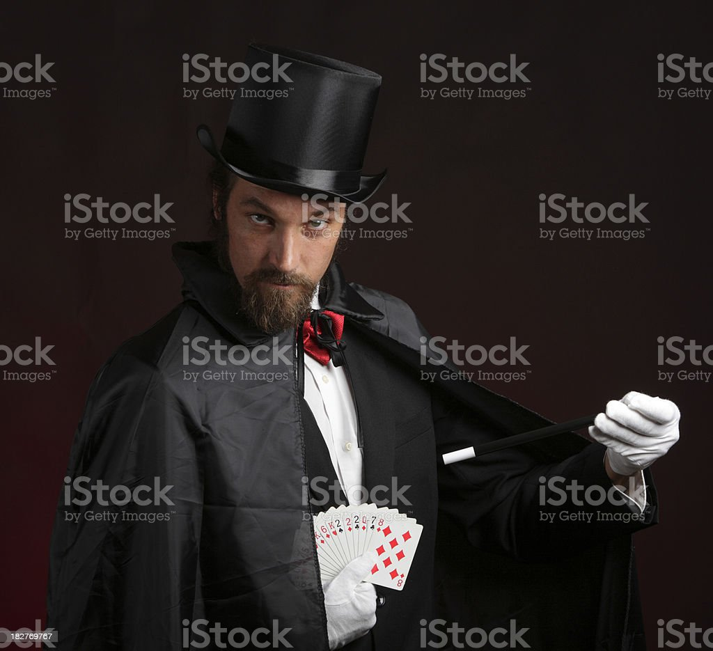 Magician Performing Card Tricks stock photo