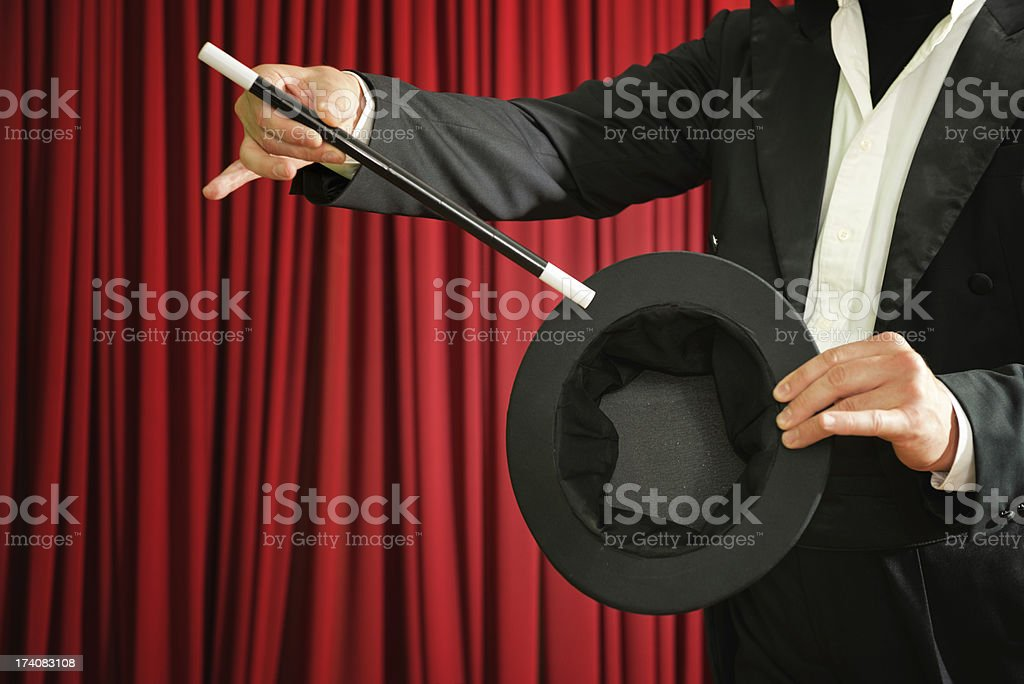 Magician performing on stage stock photo