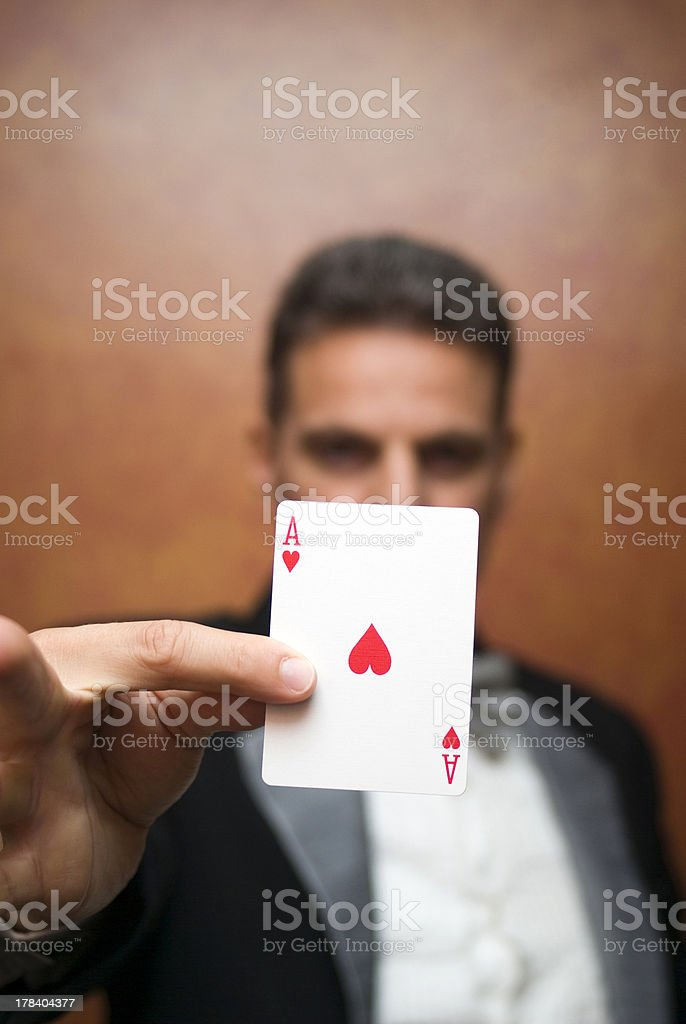 Magician performing with card stock photo