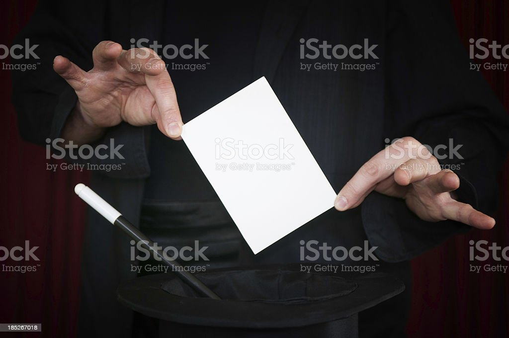 Magician presents blank card stock photo