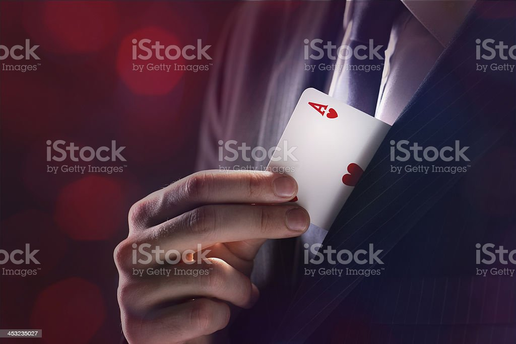 Magician pulling an ace of hearts out of his lapel stock photo