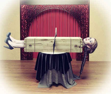 Magician sawing a woman with a saw.Photo combination concept