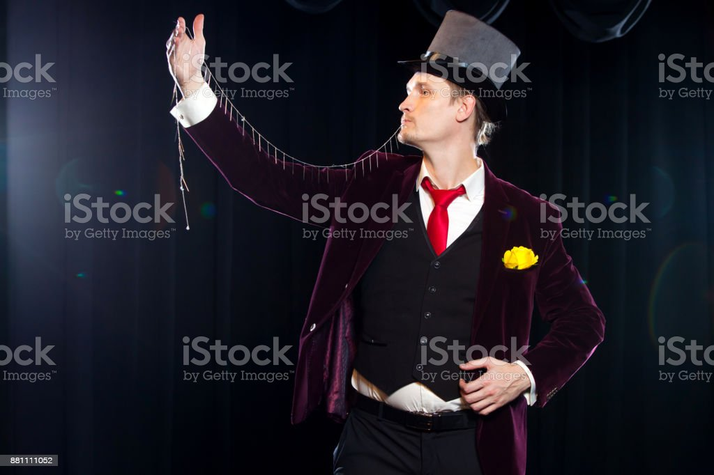 Magician with fly ball, Juggler man, Funny person, Black magic, Illusion focus with stock photo