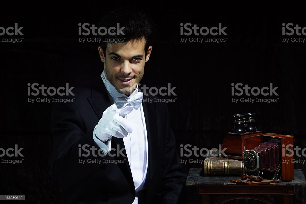 Magician with old camera stock photo