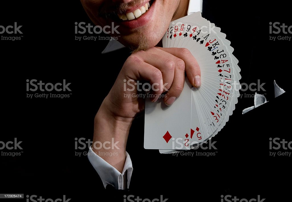 Magician with playing cards stock photo