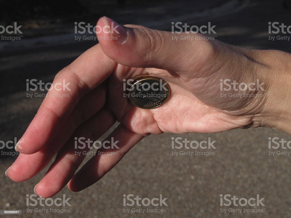 Magician's hand, close up sleight-of-hand magic trick royalty-free stock photo