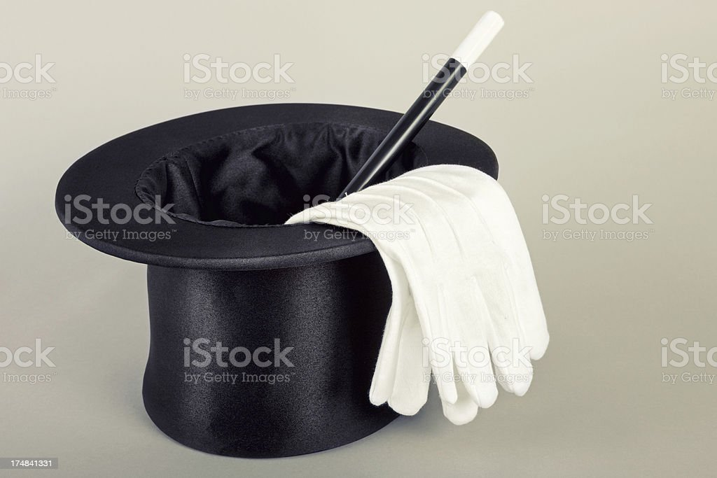 Magicians hat wand gloves stock photo
