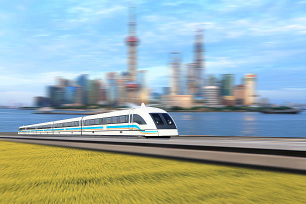 Maglev train Shanghai maglev train of the Lujiazui background. bullet train stock pictures, royalty-free photos & images