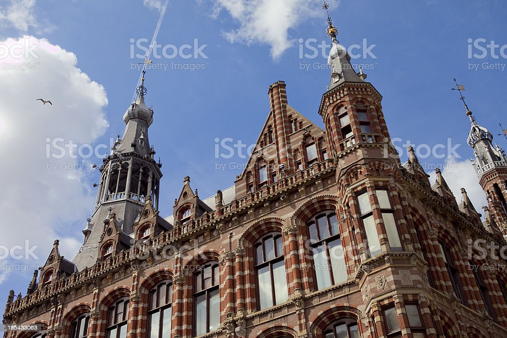Magna plaza victoreon gothic revival architecture in Amsterdam royalty-free stock photo
