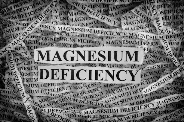 magnesium deficiency. torn pieces of paper with words magnesium deficiency. - magnesium stock photos and pictures