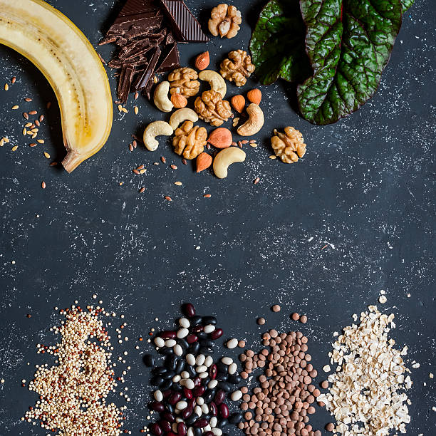 magnesium rich food -  banana, chocolate, nuts, chard, quinoa, beans - magnesium stock photos and pictures