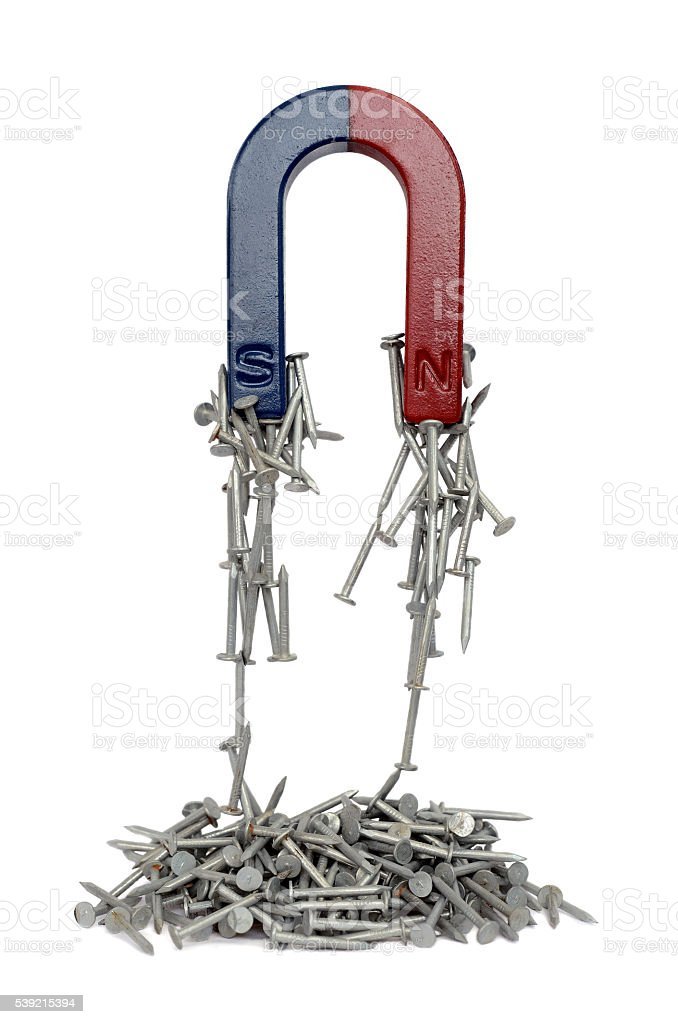 Magnet and nails. stock photo