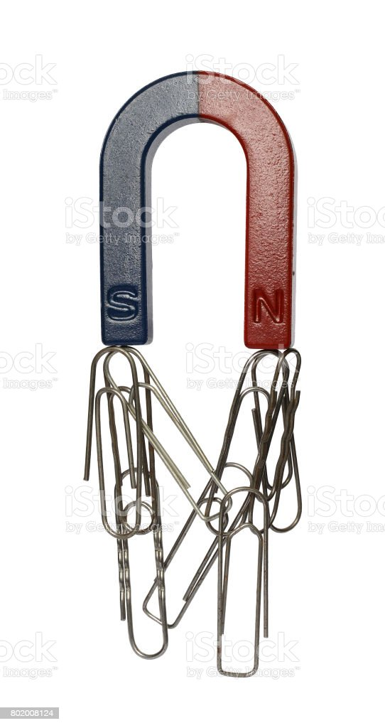 Magnet and paper clips stock photo