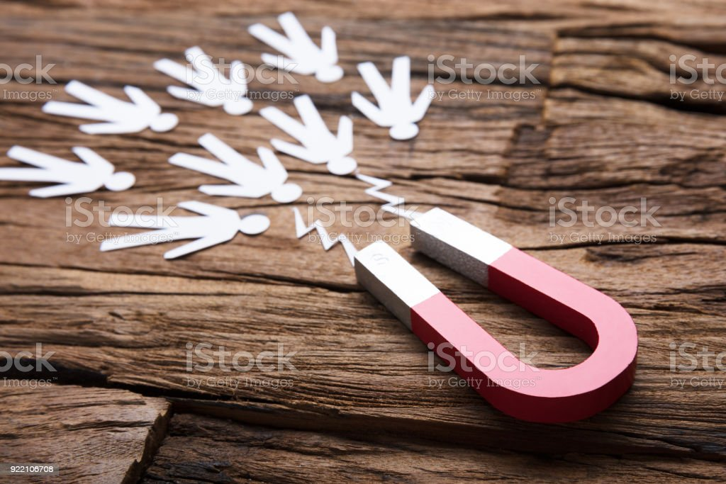 Magnet Attracting Paper Candidates On Table stock photo