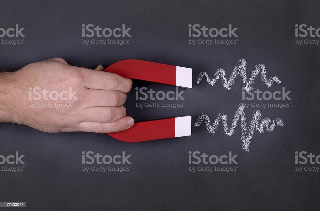 Magnet attraction stock photo
