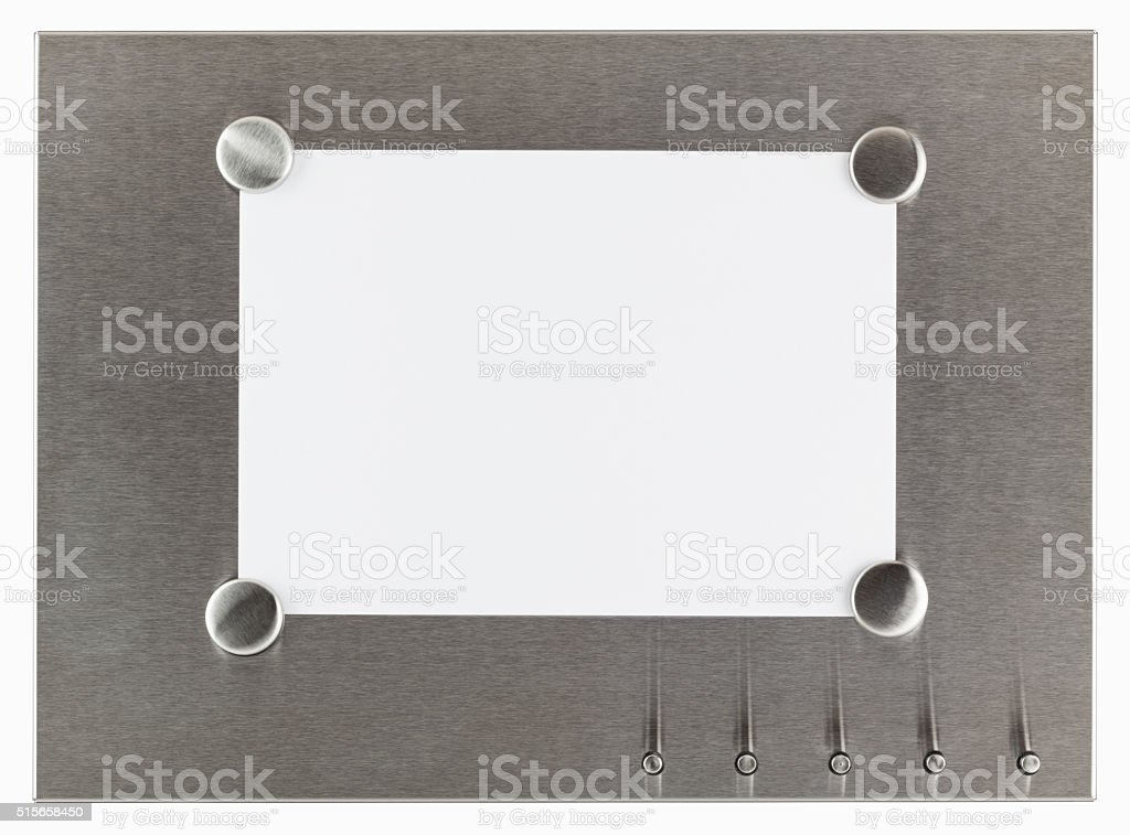 magnet pinboard with blank paper stock photo