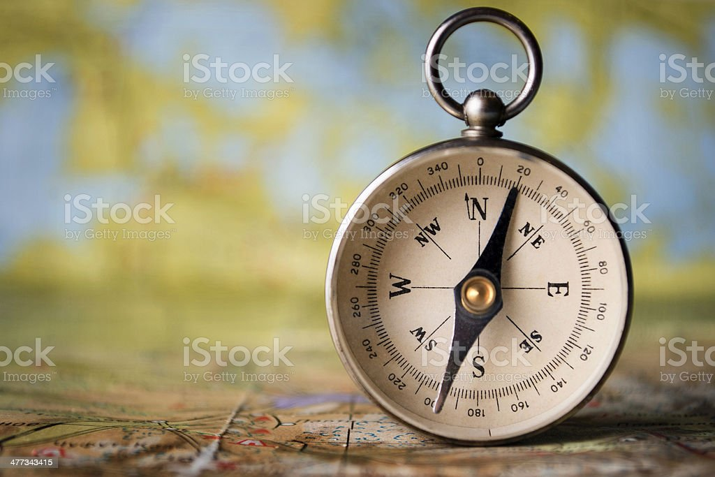 Magnetic compass on a world map stock photo
