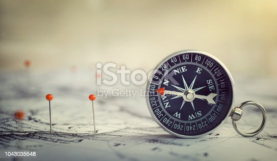 Magnetic compass on world map.Travel, geography, navigation, tourism and exploration concept background. Macro photo. Very shallow focus.