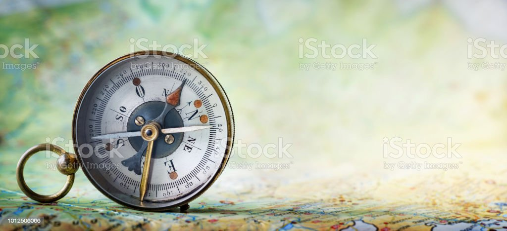 Magnetic old compass on world map. stock photo