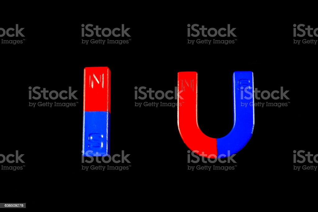 Magnetic red and blue on a black background. stock photo