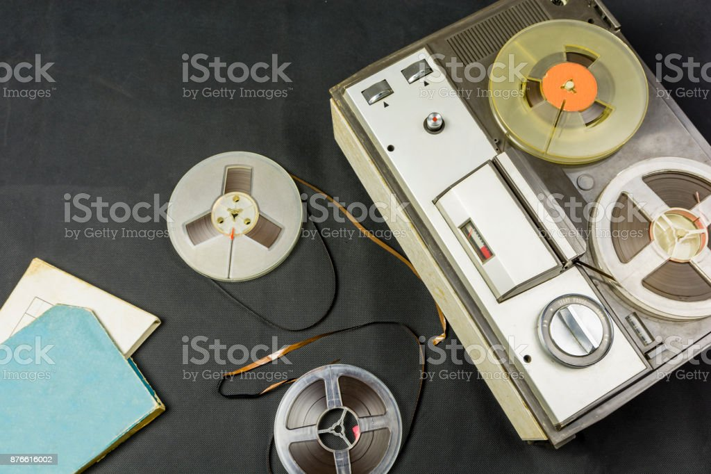 Magnetic tapes and old tape recorder. stock photo