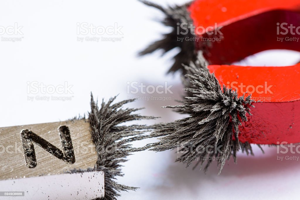 Magnets with Iron Filings stock photo