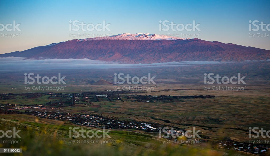 Magnificent and Snow Capped Mauna Kea Looms over the Landscape stock photo