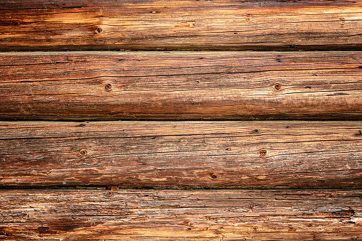 Magnificent background of a textured old wall made of brown wooden beams 2018