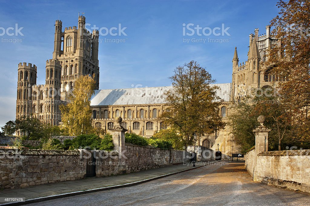Magnificent Cathedral at Ely towers above small streets in sunshine stock photo