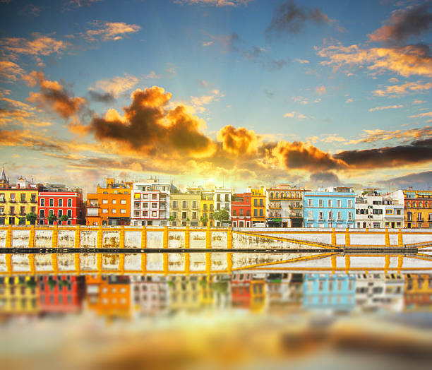 Magnificent Colorful panorama of Seville riverside Magnificent Colorful panorama of Seville riverside of Guadalquivir at sunset, Spain seville stock pictures, royalty-free photos & images