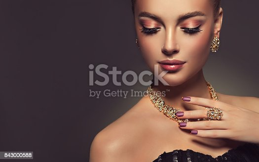 istock Magnificent lady in a perfect make up is shows jewelry set. 843000588