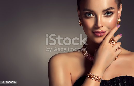 istock Magnificent lady in a perfect make up is shows jewelry set. 843000594