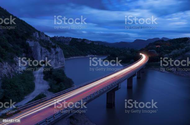 Photo of Magnificent landscape, nightscape  with light trails and the rock phenomenon The Wonderful Rocks (Balkan mountain, Bulgaria)