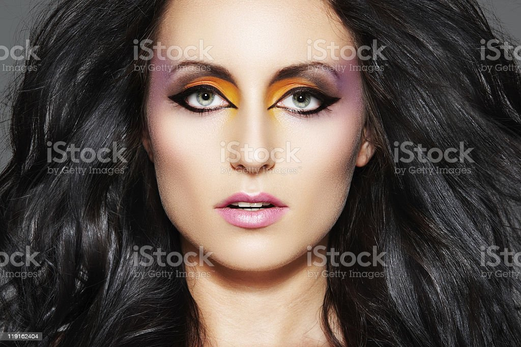 Magnificent model with beautiful oriental make-up and long volume hair royalty-free stock photo