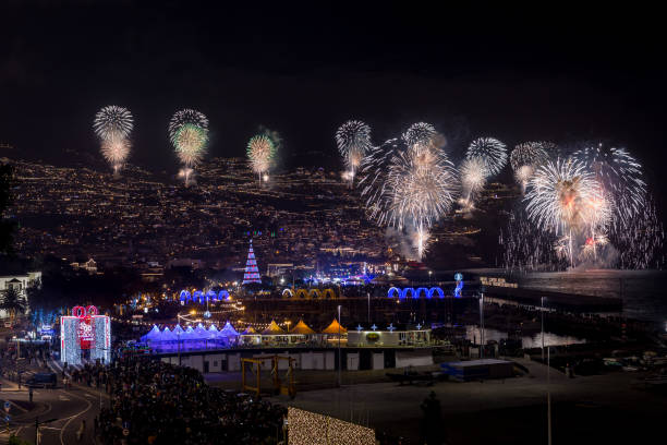 Magnificent New Year fireworks beginning of year of 2020 in Funchal city, Madeira Island, Portugal. stock photo