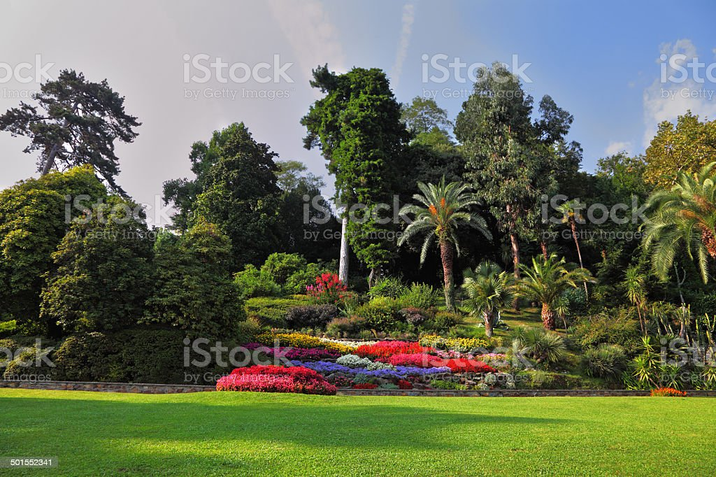 Magnificent park with  flower beds stock photo