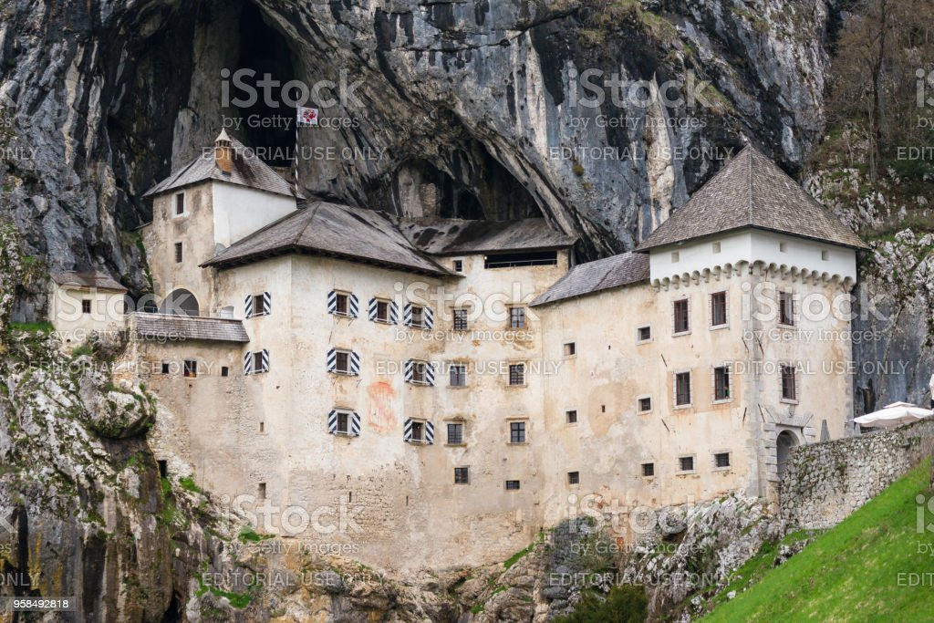 Magnificent Predjama Castle is one of the most famous landmarks in Slovenia, attracting  thousands of tourists each year. stock photo