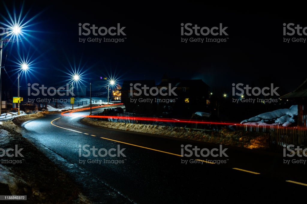 Magnificent shake the light of car lights in the evening on the...