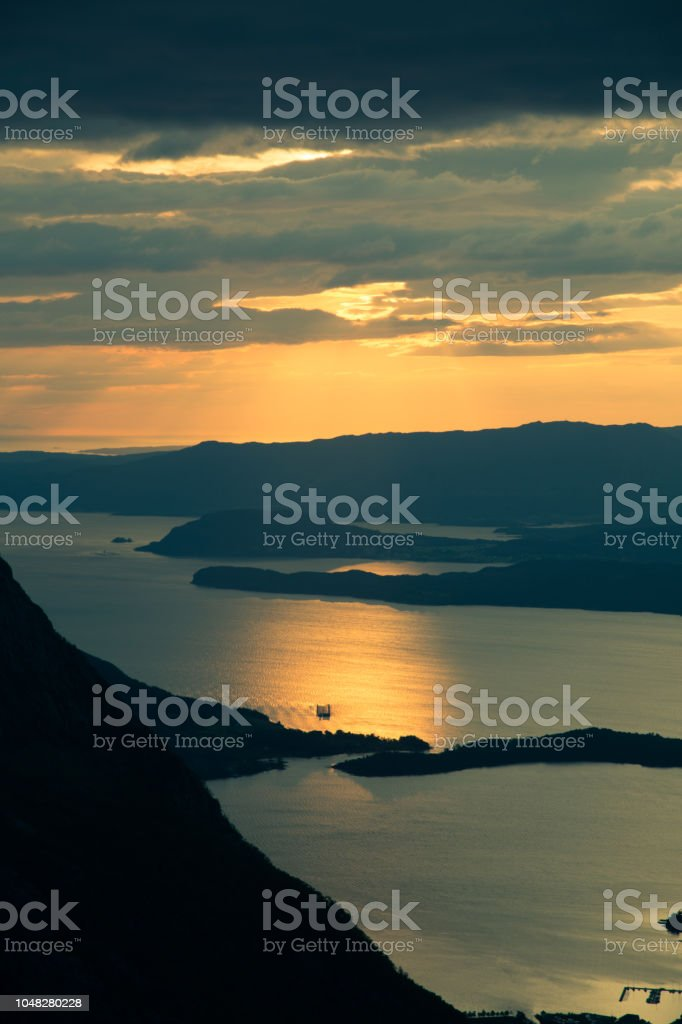 A magnificent sunset scenery over the fjords in Norway. A beautiful autumn landscape in Folgefonna national park. stock photo