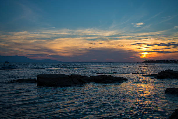Magnificent sunset view at the Agean sea coast, Greece stock photo