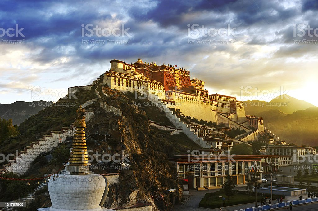 Magnificent view of Potala Palace in the hill at sunrise stock photo