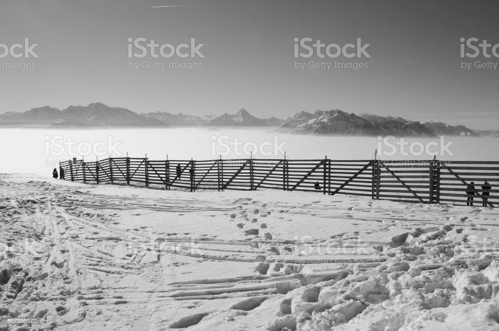 Magnificent view of the alps in winter, looking out above a layer of fog. Austria. stock photo