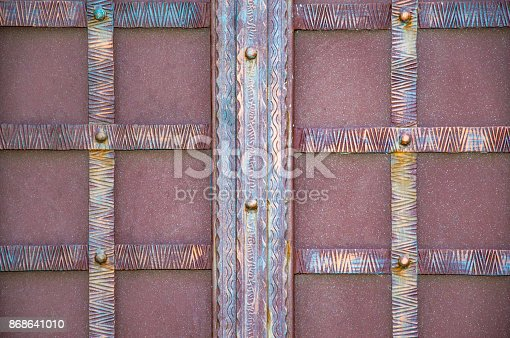 istock magnificent wrought-iron gates, ornamental forging, forged elements close-up 868641010