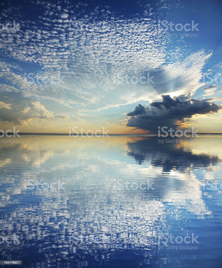 Magnificient Cloudscape With Water Reflection royalty-free stock photo