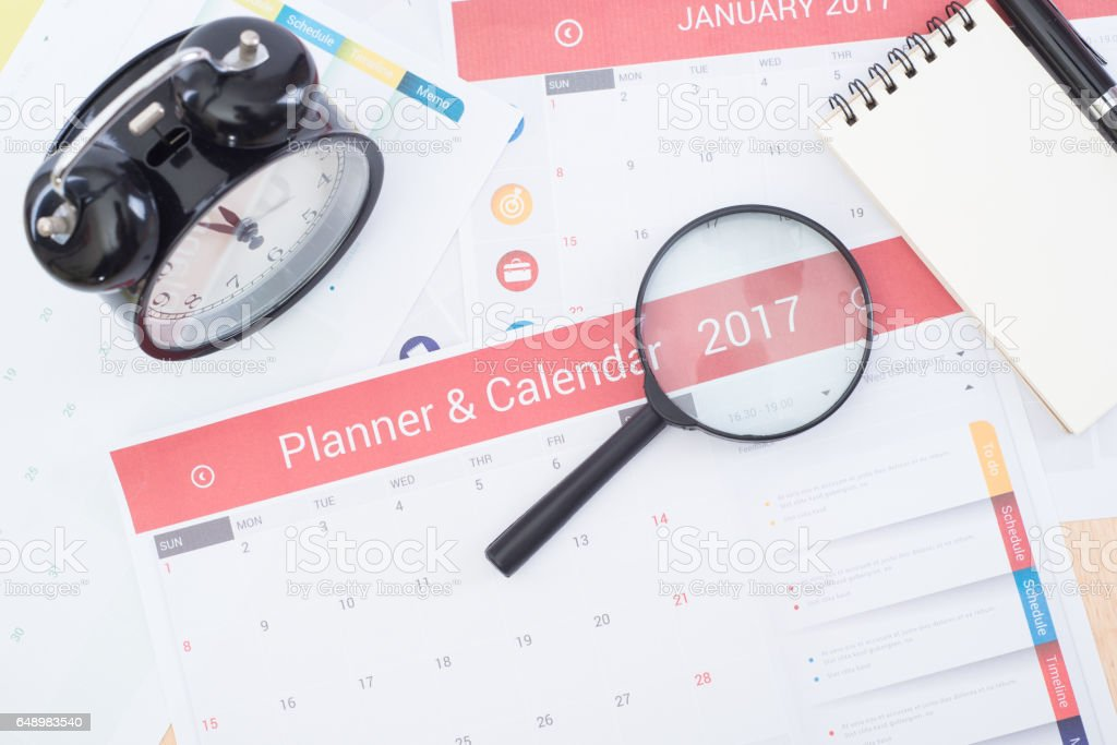 magnifier and business calender planner 2017 on desk stock photo