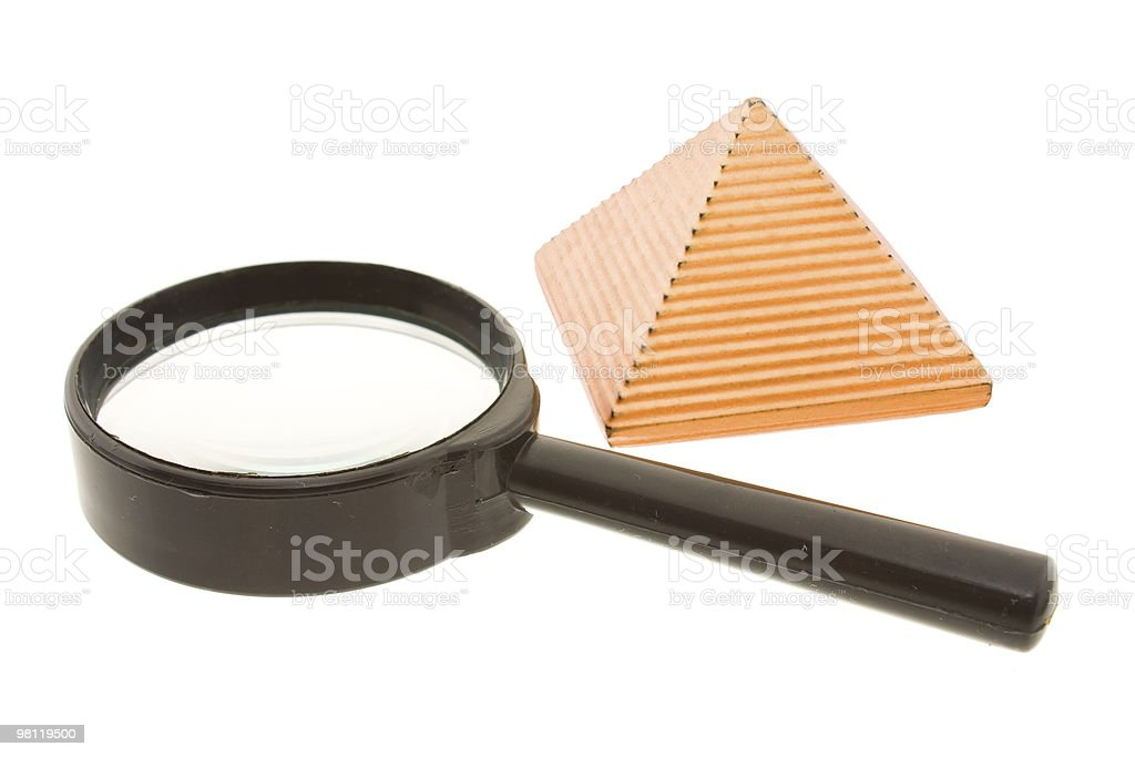 Magnifier and pyramid royalty-free stock photo