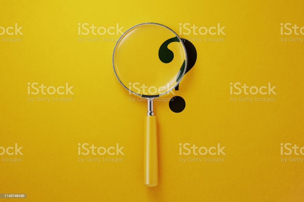Magnifier And Question Mark On Yellow Background Magnifier and question mark on yellow background. Horizontal composition with copy space. Aiming Stock Photo