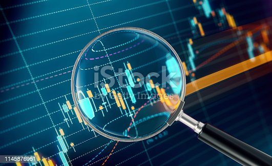 850495466 istock photo Magnifier Focusing On A Financial and Technical Data Analysis Graph 1145876951